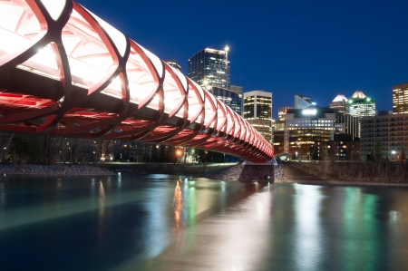 Calgary skyline and a pedestrian bridge in Calgary, Alberta Canada  The pedestrian bridge spans the Bow River Stock Photo