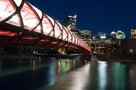 Calgary skyline and a pedestrian bridge in Calgary, Alberta Canada  The pedestrian bridge spans the Bow River photo