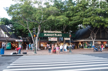 International Market Place in the evening along the famous Kalakaua shopping district in Waikiki, Hawaii. International Market Place is a famous destination for tourists and sells the boasts hundreds of vendors. Editorial