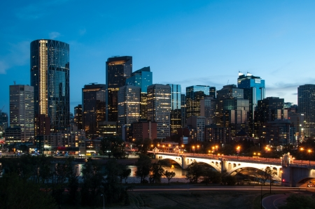 river scape: Calgary skyline at night with Bow River and Centre Street Bridge