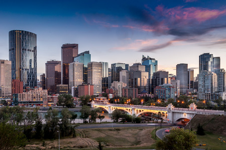 Calgary skyline at night with Bow River and Centre Street Bridge  photo