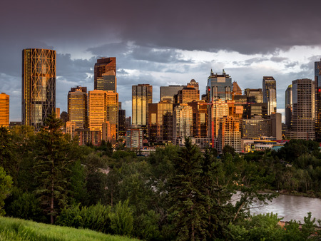 Calgary skyline at night with Bow River  Фото со стока