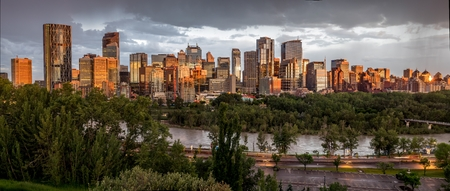 Calgary skyline at night with Bow River  photo