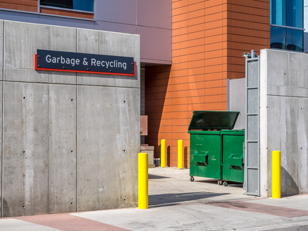 commercial recycling: Garbage and recycling sign at a loading dock on a modern commercial building