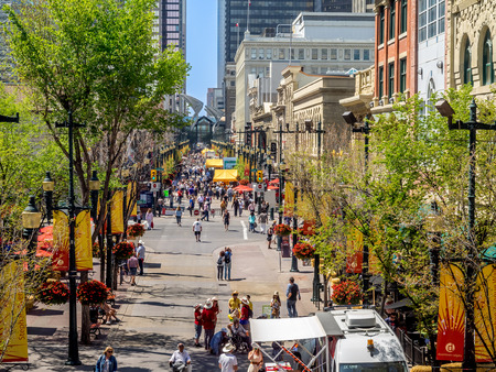 Busy Stephen Avenue in Calgary during Stampede on July 13, 2014 in Calgary, Alberta Canada  This shopping and pedestrian plaza is the heart of downtown Calgary