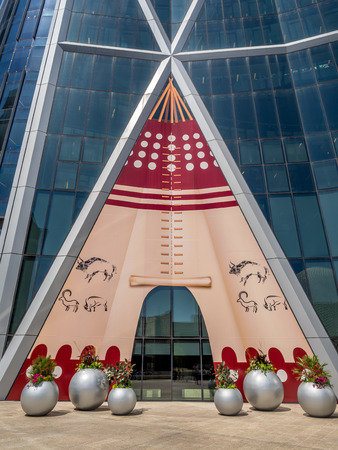 stampede: The Bow Tower decorated for the Calgary Stampede on July 13, 2014 in Calgary, Alberta Canada  Here the exterior of the Bow is decorated with a Blackfoot Indian Tepee