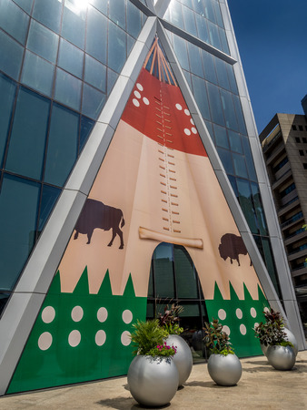 calgary stampede: The Bow Tower decorated for the Calgary Stampede on July 13, 2014 in Calgary, Alberta Canada  Here the exterior of the Bow is decorated with a Blackfoot Indian Tepee