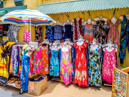 Hawaiian dresses at  King s Village gift shop and fast food mall in Waikiki