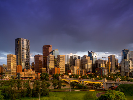 Calgary skyline at night with Bow River and Centre Street Bridge. photo