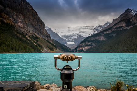 Lake Louise, Alberta, Banff National Park, Canada, with coin operated binoculars in the foreground photo