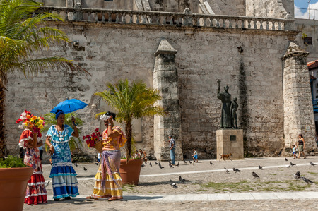 cuban culture: Buskers in period dress on June 30, 2005 in Havana.With Cuba receiving over two million tourists a year,artists representing the cuban culture are part of the atmosphere of Old Havana