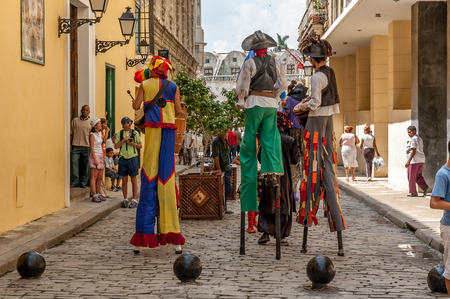 typical: Unidentified street dancers June 30, 2005 in Havana.With Cuba receiving over two million tourists a year,artists representing the cuban culture are part of the atmosphere of Old Havana Editorial