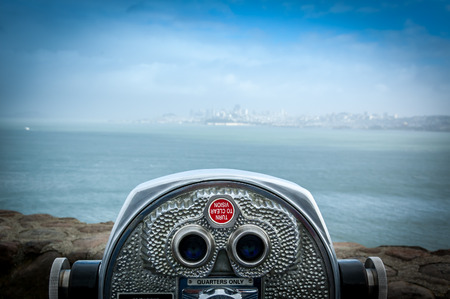 binoculars: Binocular next to the waterside promenade in San Francisco looking out to the Bay.