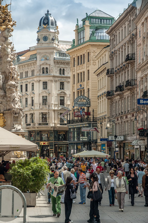 listing: Main pedestrian street in central Vienna on May 20, 2006, in Vienna, Austria. The pedestrian dominated centre of Vienna is packed with tourists and great shopping.