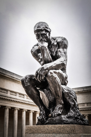 sculptures: Rodins The Thinker statue in bronze in San Francisco on August 18, 2009.  The Thinker Statue is located in the courtyard of the Palace of the Legion of Honor. Editorial