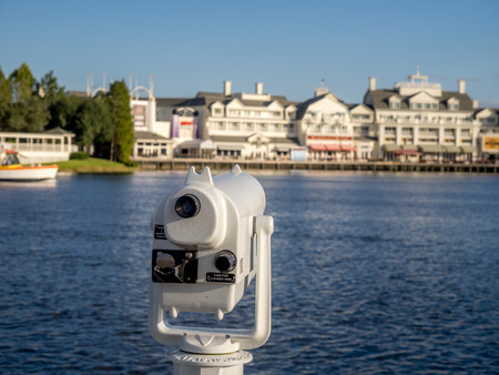 Coin-operated binoculars looking toward the Boardwalk Hotel, Disney World.