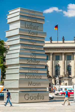 Cultural exhibit in front of the Humboldt University in Berlin, Germany. The Cultural exhibit relates to famous German authors and is in the form of stacked books.