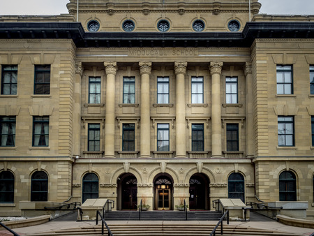 govt: The front facade of the McDougall School building on March 15, 2015 in Calgary, Alberta Canada. This old school building is now used as office space for the provincial govt.