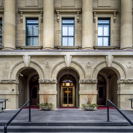 The front facade of the McDougall School building on March 15, 2015 in Calgary, Alberta Canada. This old school building is now used as office space for the provincial govt.