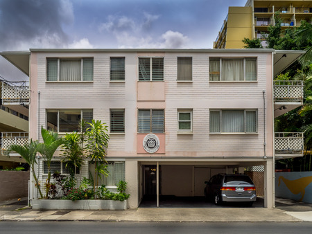 better: Older apartment building on April 26, 2014 in Waikiki, Hawaii. Waikiki has many apartments buildings that have seen better days, but support the surf culture.