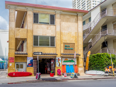 rentals: Surf shop in older building on April 26, 2014 in Waikiki, Hawaii. Waikiki has many surf shops off the beaten path that offer sales and rentals to locals and tourists alike. Editorial