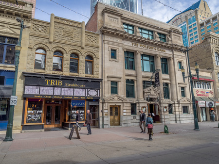 molson: Pedestrians walking past retail outlets along Stephen Ave on March 26, 2015 in Calgary, Alberta. Stephen Ave is a famous pedestrian mall in downtown Calgary Editorial