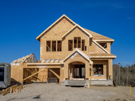 framing: Suburban estate home under construction in Aspen Woods on April 26 2015 in Calgary Alberta. In the framing stage this home is typical of upscale Calgary suburbs.