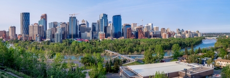 financial cliff: Calgary Canada  May 24 2015: Early morning along Calgarys Bow River with the downtown skyscrapers in the distance.