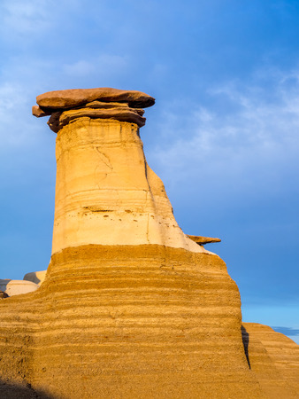 bathed: Hoodoos bathed in the warm light of a summer sunset at Drumheller Alberta Canada.