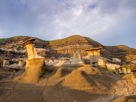 discolored: Hoodoos bathed in the warm light of a summer sunset at Drumheller Alberta Canada.