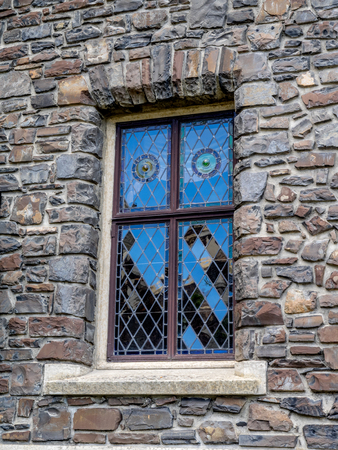 stain glass: Stain glass window on exterior wall of the Banff Springs Hotel.