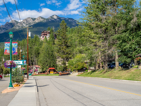 radium: RADIUM HOT SPRINGS, CANADA - AUG 8, 2015: Hotels in the town of Radium Hot Springs sign on August 8, 2015 in the Canadian Rockies. Radium Hot Springs is located in BC and is a popular destination.