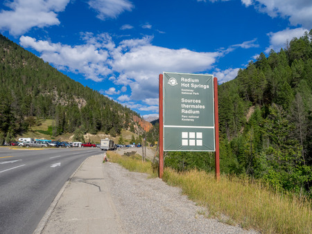 radium: RADIUM HOT SPRINGS, CANADA - AUG 8, 2015: The Radium Hot Springs sign on August 8, 2015 in the Canadian Rockies. Radium Hot Springs is located in Kootenay National Parks and is a popular destination.