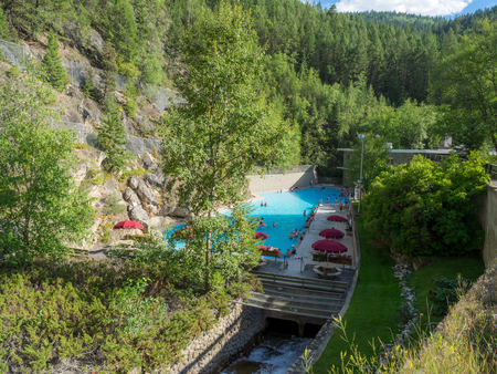 RADIUM HOT SPRINGS, CANADA - AUG 8, 2015: The Radium Hot Springs Pool on August 8, 2015 in the Canadian Rockies. Radium Hot Springs is located in Kootenay National Parks and is a popular destination.
