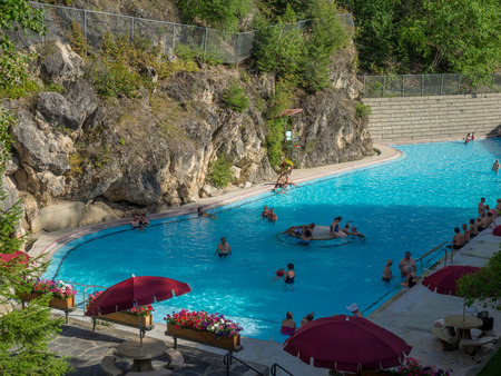 radium: RADIUM HOT SPRINGS, CANADA - AUG 8, 2015: The Radium Hot Springs Pool on August 8, 2015 in the Canadian Rockies. Radium Hot Springs is located in Kootenay National Parks and is a popular destination.