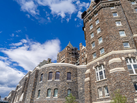 rockies: BANFF, CANADA - AUG 9, 2015: The Banff Springs Hotel on August 9, 2015 in the Canadian Rockies. The Banff Springs Hotel was built during the 19th century in Scottish Baronial style.