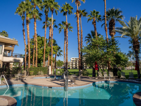 valley below: Swimming pool at a palm desert resort in California. Stock Photo