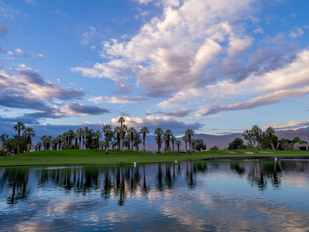 golf of california: Beautiful sunrise over a water feature on a golf course in Palm Desert California. Stock Photo