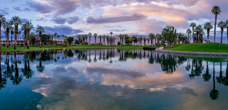 water feature: Beautiful sunrise over a water feature on a golf course in Palm Desert California. Stock Photo