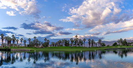 Beautiful sunrise over a water feature on a golf course in Palm Desert California. Stock Photo