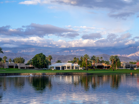 water feature: Luxury homes along a golf course in Palm Desert California during a beautiful sunrise over a water feature on a golf. Editorial