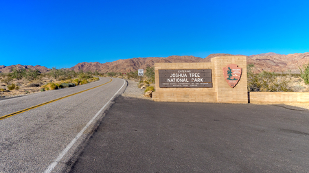 ecosystems: JOSHUA TREE NATIONAL PARK - NOV 14: Entrance sign to Joshua Tree National Park on November 14, 2015 in California. The park includes the meeting of the Mojave and the Colorado desert ecosystems. Editorial