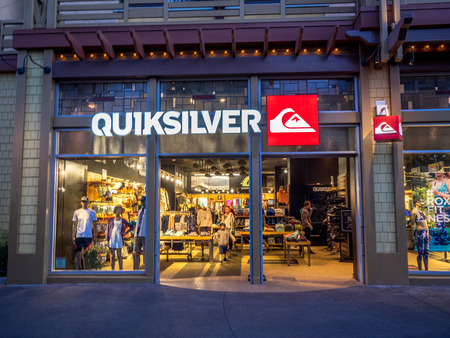 entertainment district: Quicksilver store at Downtown Disney shopping and entertainment district at night in Anaheim California. Editorial
