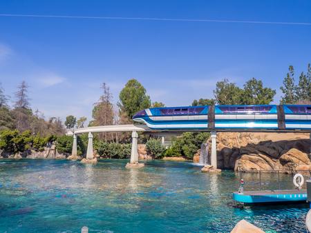 monorail: ANAHEIM, CALIFORNIA: Disneyland monorail going over the the Finding Nemo Submarine Voyage in Disneyland.