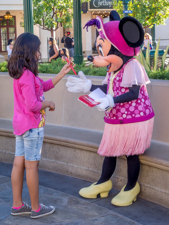 minnie mouse: ANAHEIM, CALIFORNIA - FEBRUARY 15: Girl meeting Minnie Mouse at Disney California Adventure Park on February 15, 2016 in Anaheim, California. Disney California Adventure Park is themed after the history and culture of California. Editorial