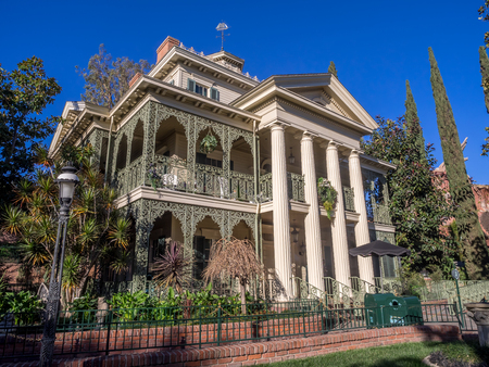 ANAHEIM, CALIFORNIA - FEBRUARY 15: Facade of the Haunted Mansion ride at the Disneyland Park on February 15, 2016 in Anaheim, California. Disneyland is Walt Disneys original theme park.