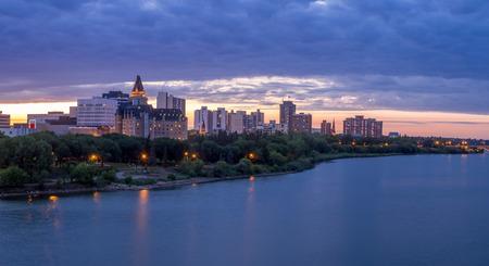 saskatchewan: Saskatoon skyline at night along the Saskatchewan River.