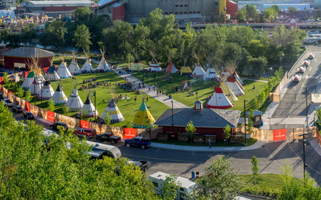 cree: CALGARY, CANADA - JULY 8: Panoramic view of the Indian Village at the Calgary Stampede on July 8, 2016 in Calgary, Alberta. The Indian Village represents First Nations people at the Calgary Stampede.