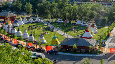 stampede: CALGARY, CANADA - JULY 8: Panoramic view of the Indian Village at the Calgary Stampede on July 8, 2016 in Calgary, Alberta. The Indian Village represents First Nations people at the Calgary Stampede.