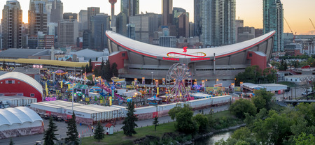 CALGARY, CANADA - JULY 8: Panoramic view of the the Calgary Stampede at sunset on July 8, 2016 in Calgary, Alberta. The Calgary Stampede is often called the greatest outdoor show on Earth. Editorial